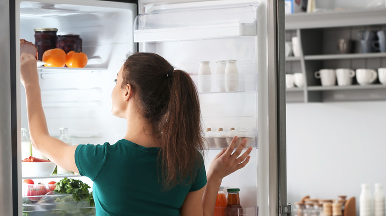 Woman taking food out of the refrigerator