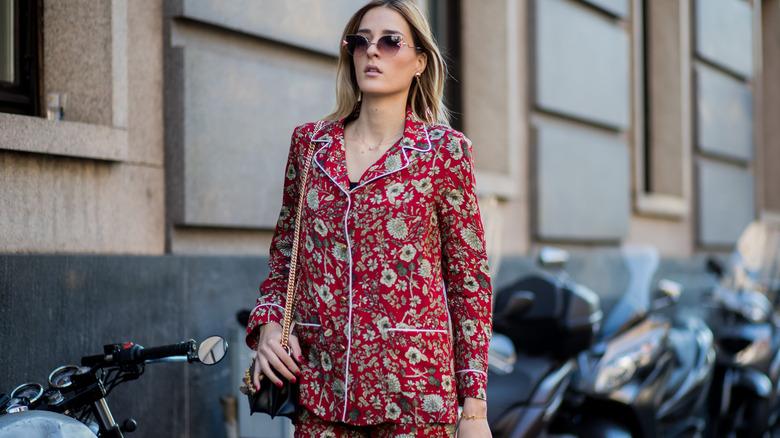 woman walking outside in stylish PJs