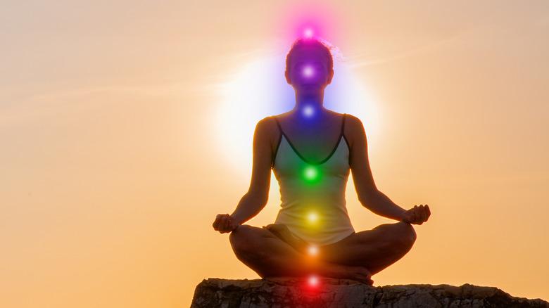Woman with lit seven chakras