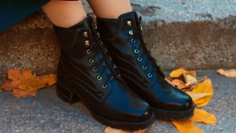 Woman wearing chunky boots in autumn