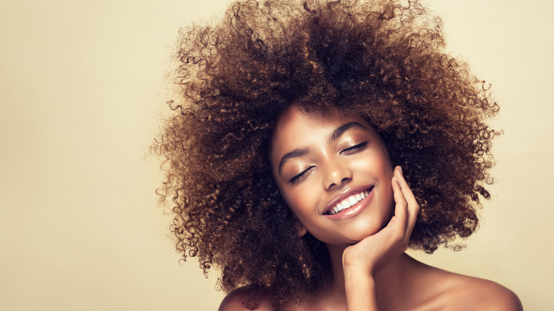 woman with big curly hair