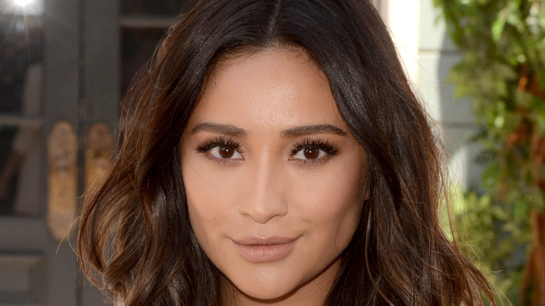 Shay Mitchell smiling