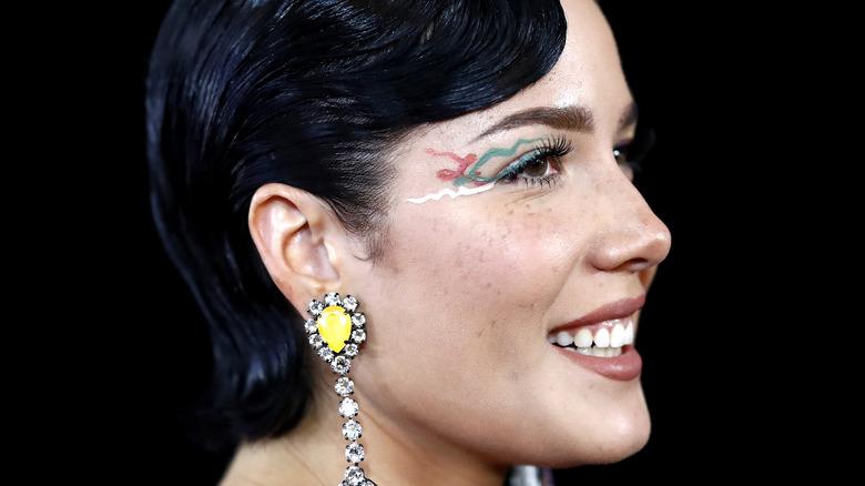 Halsey showcasing a unique makeup look at an event