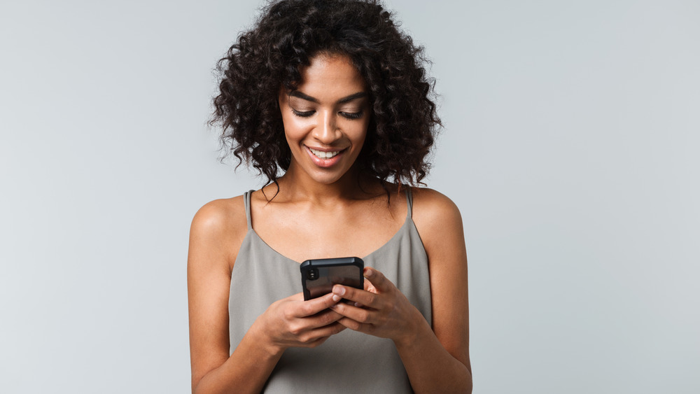 beautiful woman looking at phone