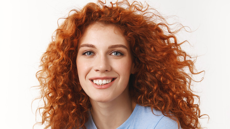 a woman with long curly hair