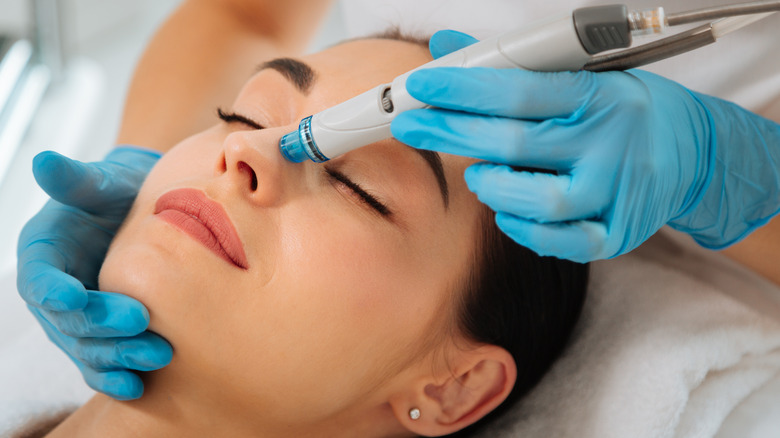 Person getting a hydrafacial treatment