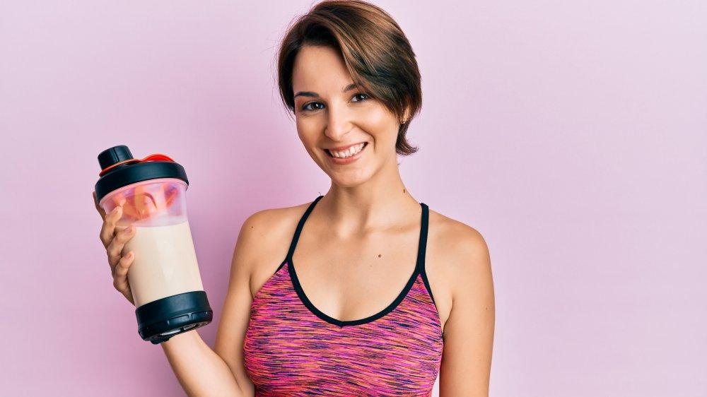 woman holding diet shake