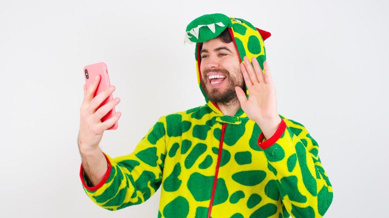 man wearing dinosaur onesie costume