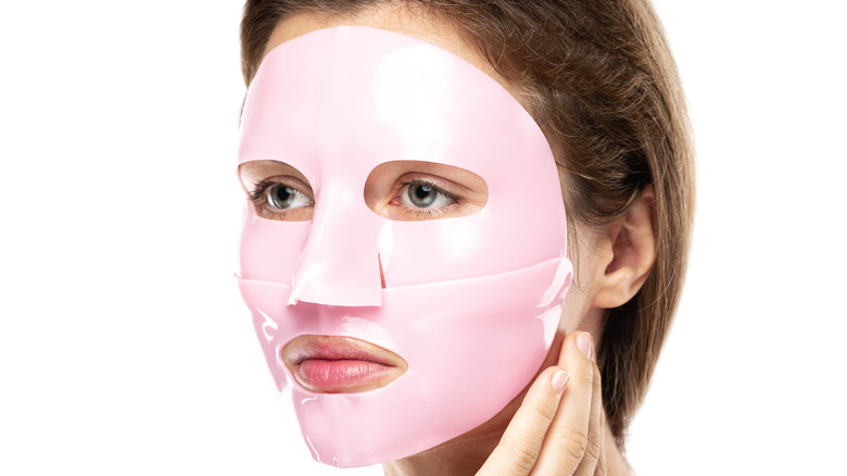 young woman wearing pink rubber face mask