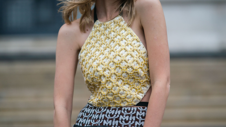 cropped halter tucked into pants