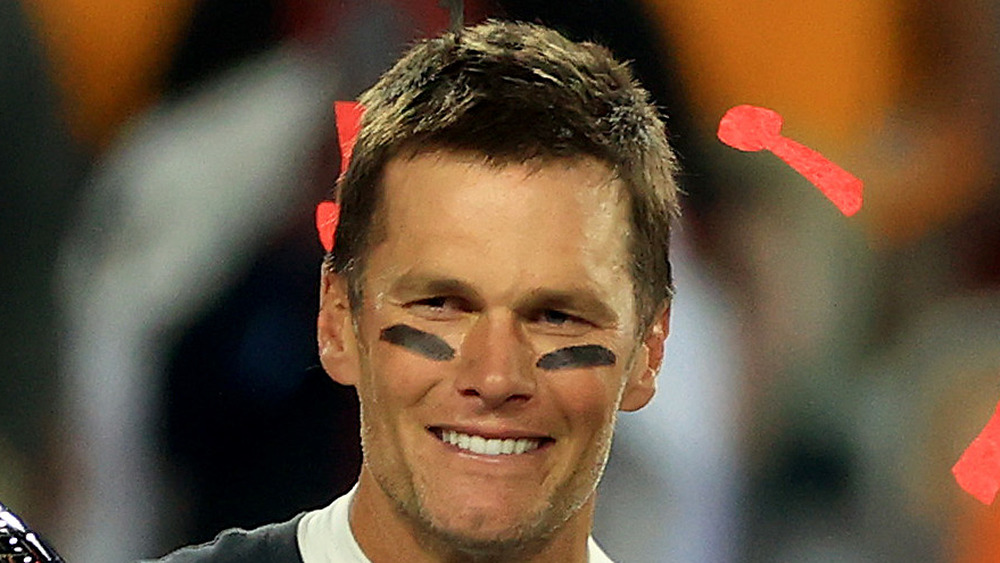 Tom Brady smiling after Super Bowl win with confetti eye black