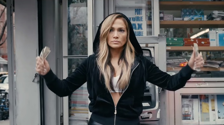 J-Lo with fists full of cash in Hustlers