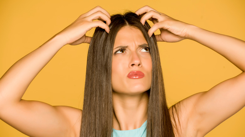 Woman with an itchy scalp