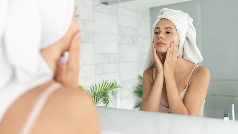 Woman applying product to face