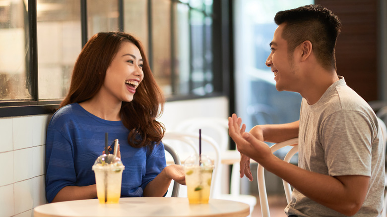 Couple laughing on a date
