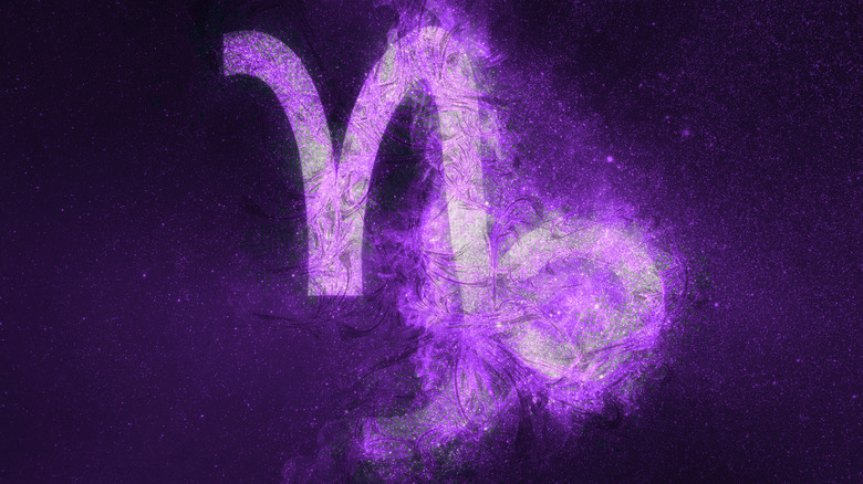 Purple Capricorn symbol in night sky