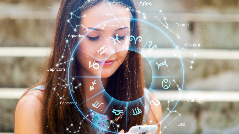 Woman on phone with astrological chart