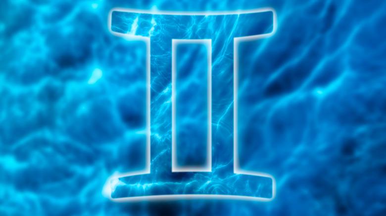Gemini sign blue background