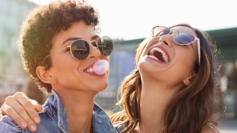 Two friends laughing with sunglasses