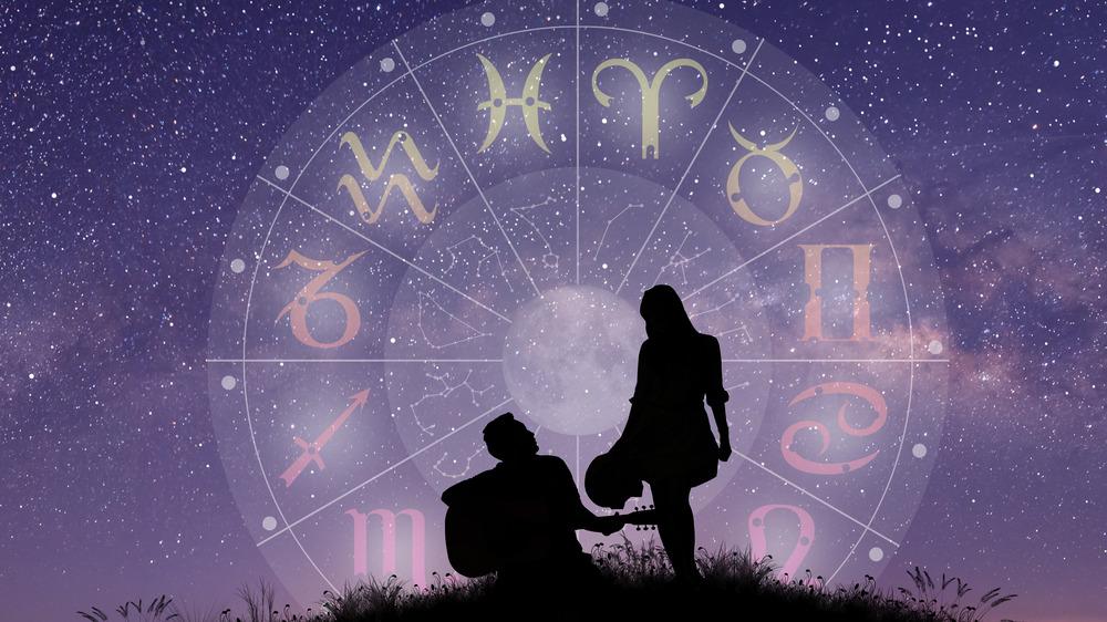 Couple under an astrology chart
