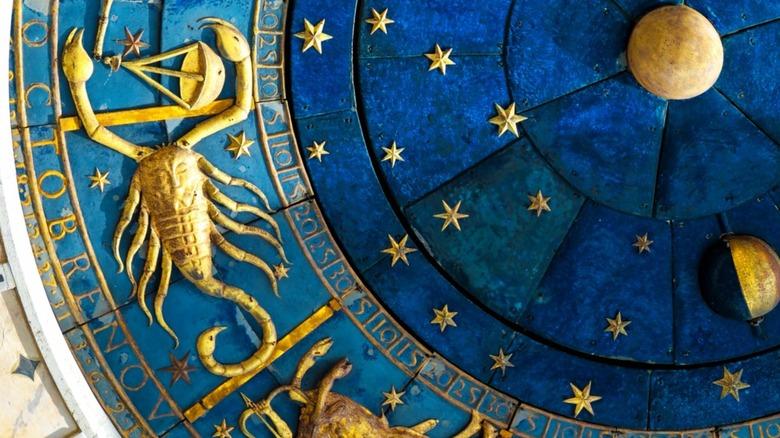 Scorpio symbol in zodiac wheel
