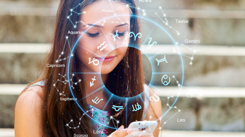 Woman looking at phone with star signs surrounding