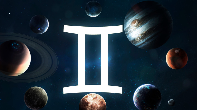 Gemini symbol surrounded by many planets