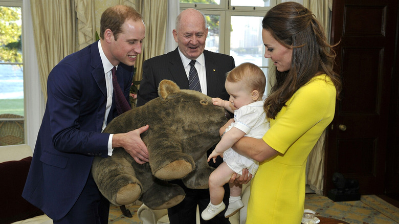 Prince George receiving a gift