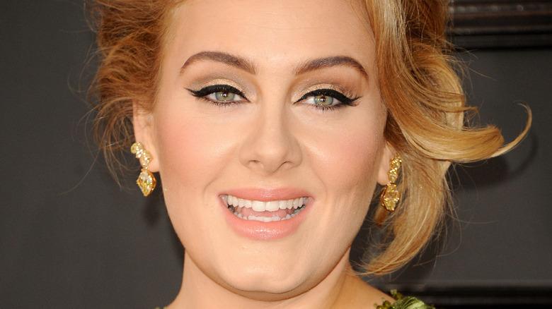 Adele smilrs                                                                                                                                                                                                                                                                                                                                                                                                                                                                                                                                                                                                                                                                                                                                                                                                                                                                                                                                                                                                                                                               on the Grammy red carpet