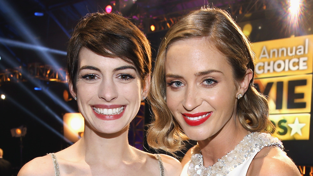 Anne Hathaway and Emily Blunt at an awards ceremony
