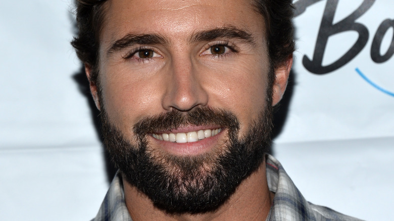 Brody Jenner smiles for the camera.
