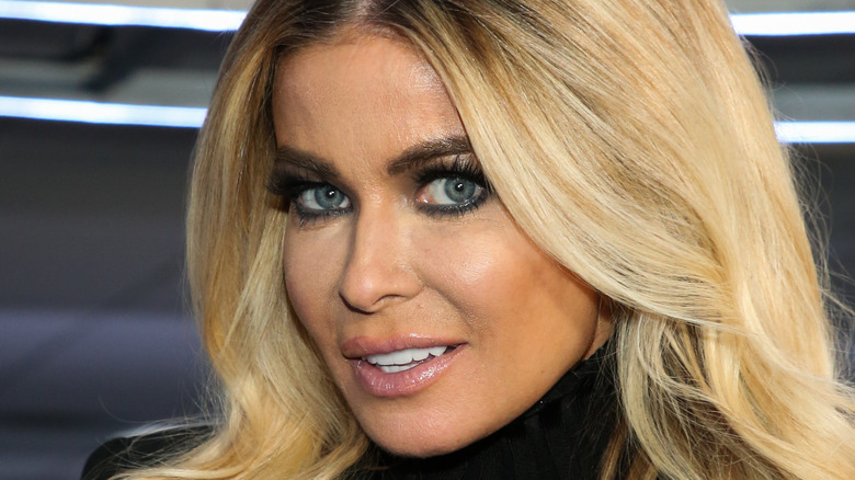 Carmen Electra wears all black at an event