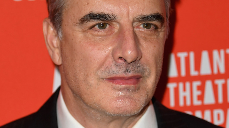 Chris Noth with serious expression on the red carpet