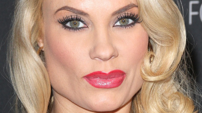 close up of Coco Austin wearing red lipstick