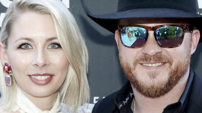 Cody Johnson and wife Brandi posing