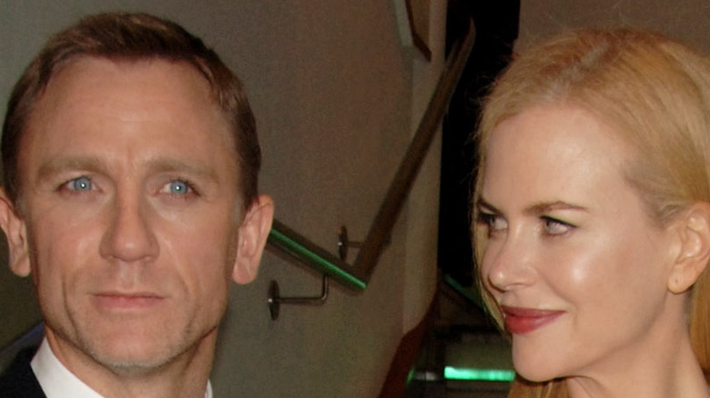 """Daniel Craig and Nicole Kidman posing at the premiere of their film """"The Invasion"""""""