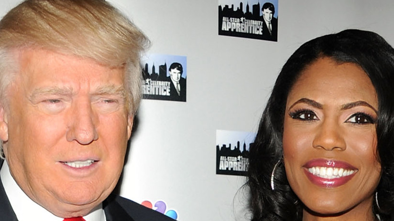 Omarosa and Donald Trump smiling
