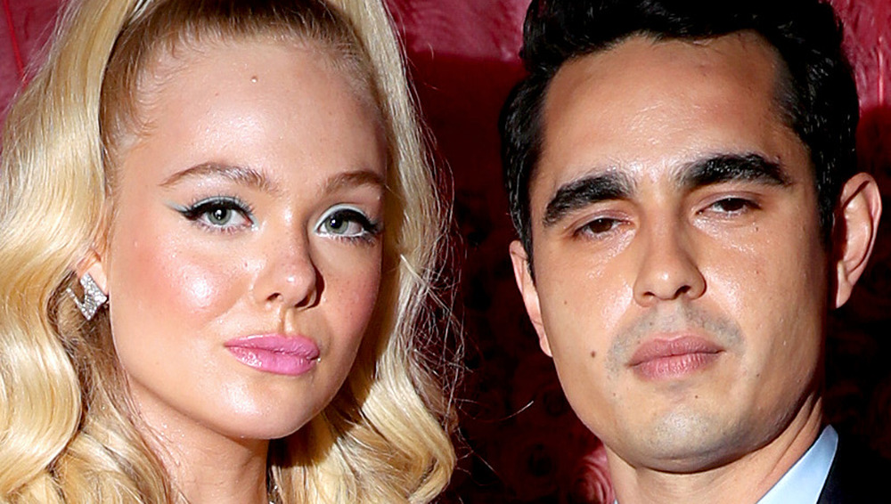 Elle Fanning and Max Minghella pose at an event together