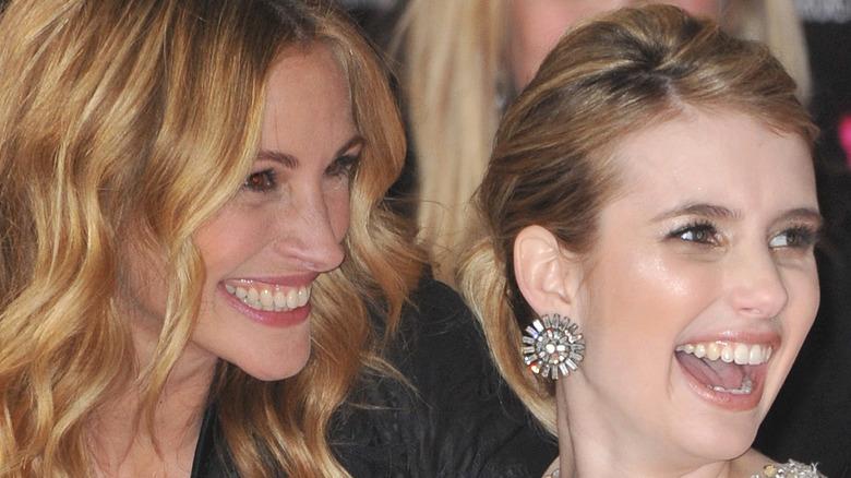 Emma Roberts and Julia Roberts smiling at a movie premiere