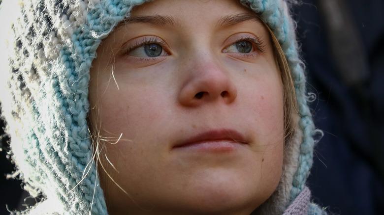 Greta Thunberg looking serious in knit hat