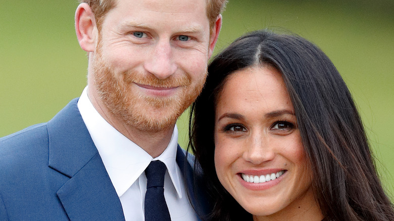 Prince Harry and Meghan Markle pose for pictures during their engagement announcement