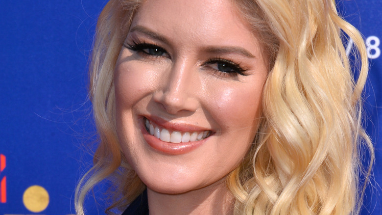 Heidi Montag with wide smile at an event