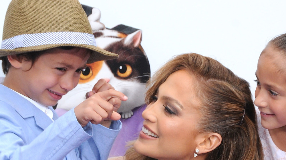 Jennifer Lopez and son Max Muniz in front of a cat