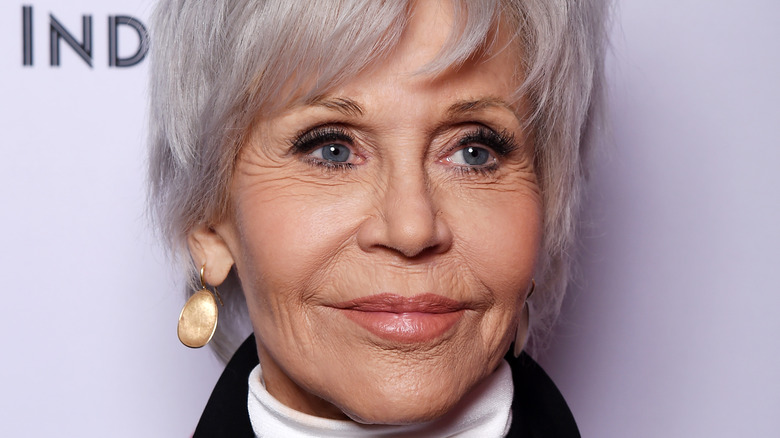 Jane Fonda grinning with short grey hair