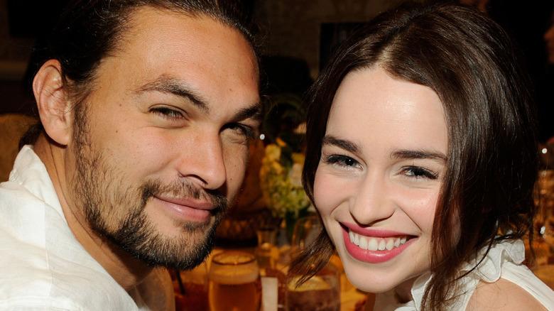 Jason Momoa and Emilia Clarke at an event