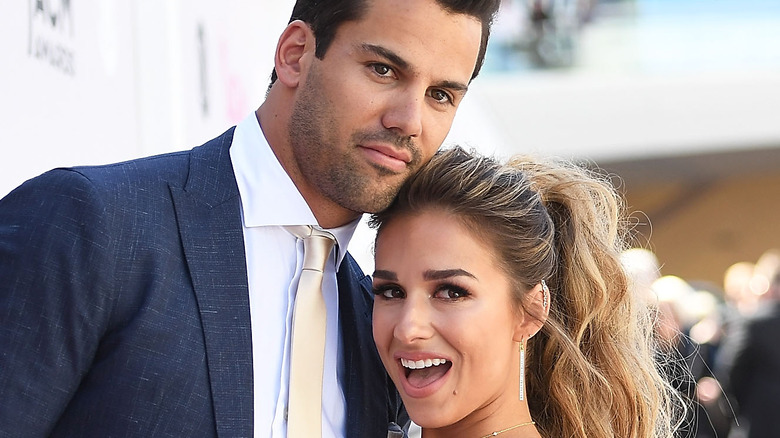 Jessie James Decker and Eric Decker pose for a photo