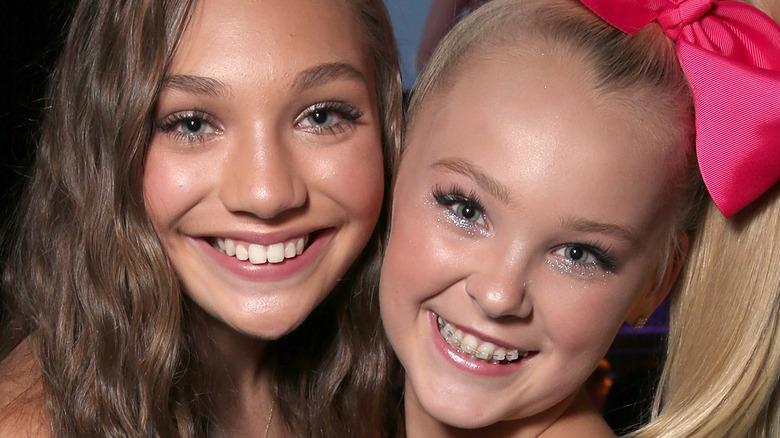 Maddie Ziegler and Jojo Siwa smiling