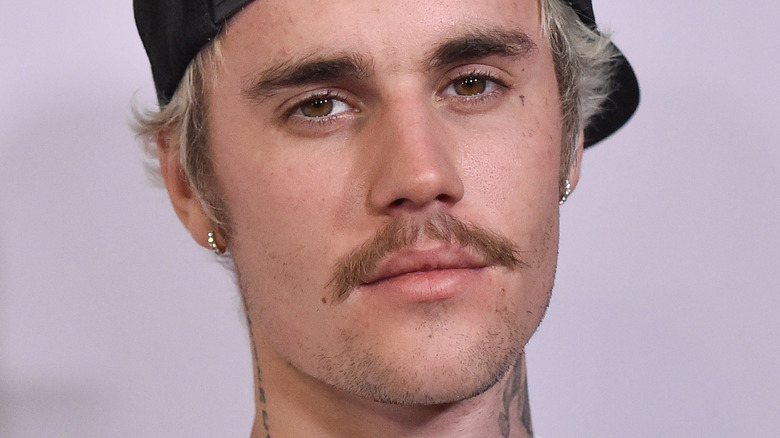 Justin Bieber with backwards cap