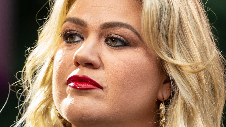 Kelly Clarkson staring off