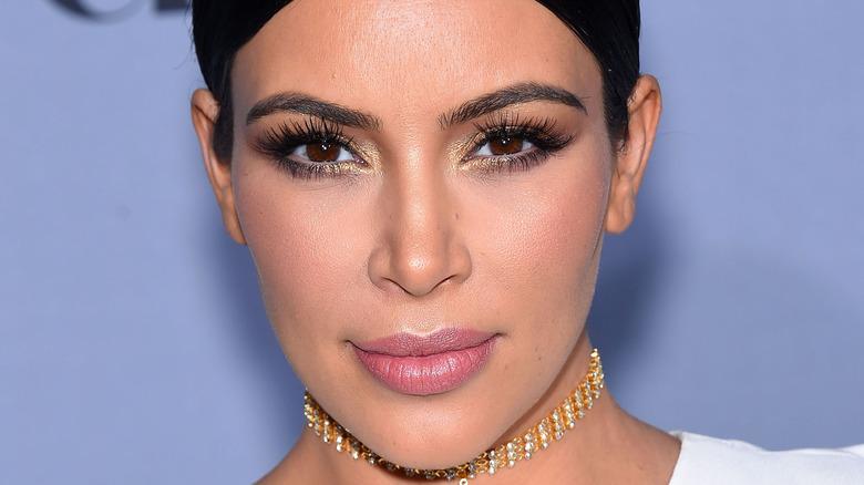 Kim Kardashian smiling on the red carpet.